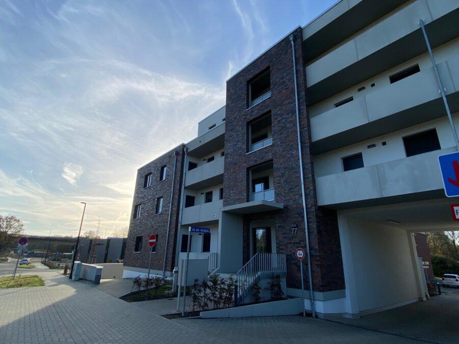 Moderne Wohnung mit offener Wohnküche und idealem Schnitt - Außenansicht