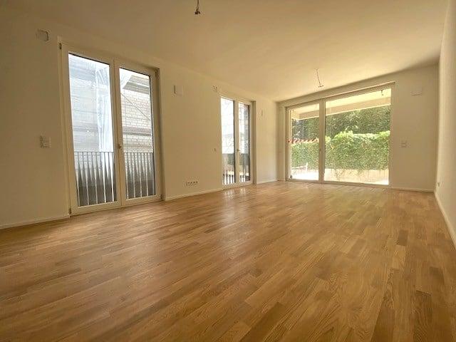 Terrassen-Maisonette am Alsterpark - Erstbezg mit Bad en Suite und großer Ankleide! - Wohnzimmer